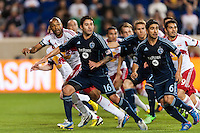 Sporting Kansas City players including Claudio Bieler (16) and Paulo Nagamura (6) as well as New York Red Bulls Thierry Henry (14) and Fabian Espindola (9) move toward goal on a free kick. Sporting Kansas City defeated the New York Red Bulls 1-0 during a Major League Soccer (MLS) match at Red Bull Arena in Harrison, NJ, on April 17, 2013.