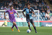 Sido Jombati of Wycombe Wanderers moves away from Graham Carey of Plymouth Argyle during the Sky Bet League 2 match between Wycombe Wanderers and Plymouth Argyle at Adams Park, High Wycombe, England on 12 September 2015. Photo by Andy Rowland.