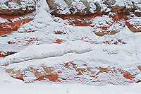 Red rock with falling snow<br /> <br /> Nipigon<br /> Ontario<br /> Canada
