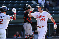 Infielder David Chester (44) of the Greenville Drive, right, is congratulated after scoring a run in a game against the Delmarva Shorebirds on Monday, April 29, 2013, at Fluor Field at the West End in Greenville, South Carolina. Delmarva won, 6-5 in game one of a doubleheader. (Tom Priddy/Four Seam Images)