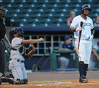 NWA Democrat-Gazette/ANDY SHUPE<br /> Northwest Arkansas Naturals right fielder Jorge Bonifacio (right) reacts to a called second strike Wednesday, Aug. 12, 2015, against San Antonio starter Ronald Herrera during the third inning at Arvest Ballpark in Springdale.