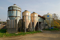 "A biogas plant in Kuzumaki. The plant extracts methane from manure then burns it to produce electricity. Kuzumaki in Northern Japan bills itself as a town of ""Milk, wine and clean energy"". The 8000 population town has little local industry so Kuzumaki invited Japanese companies to set up wind, solar and biogas generating plants."