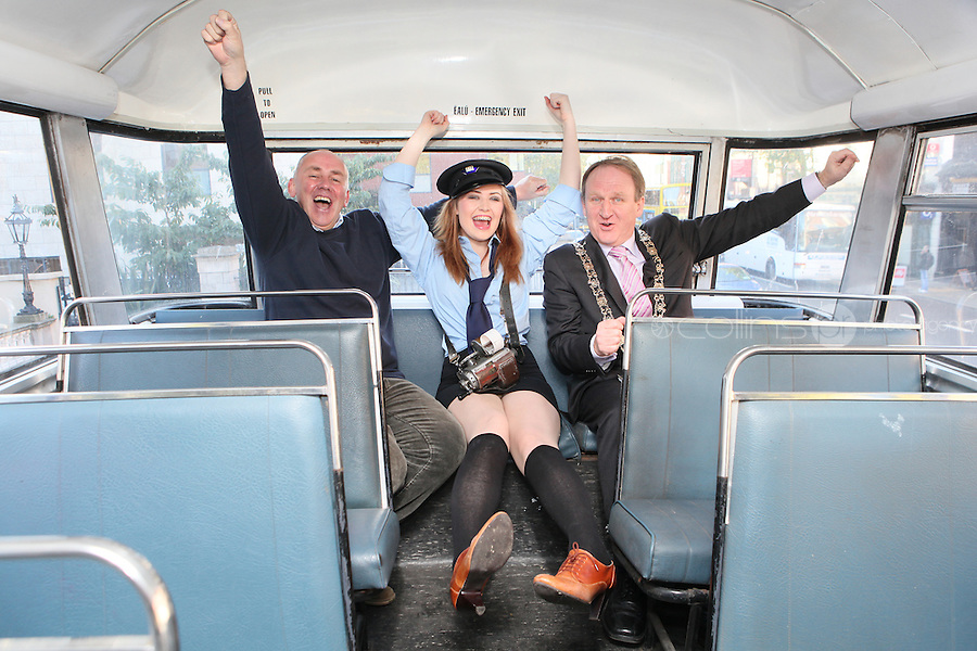 """NO FEE. 20/10/2010. Vintage CIE Double Decker Bus Makes One Last Stop . Beautiful 'conductor' Jane Kendlin, The Lord Mayor, Cllr Gerry Breen and Dublin based bus enthusiast Ed O'Neil are pictured in full conductor's uniform to mark the launch oftwo new books on CIE Buses in the 1970's and 1980's, avintage CIE double decker bus, outside the Mansion House on Dawson Street, Dublin.he coffee table books have been published by PRC Publications, a new transport publications company based in Dublin, and feature a miscellany of photographs of Irish buses and street scenes in both rural and urban locations, taken by Ed O'Neill from mid 1970 to mid 1980. A self-confessed """"bus nut"""", O'Neill has compiled the two books which will appeal to both enthusiasts and the general public alike. Urban street scenes, including traffic on Dublin's Grafton Street, will remind readers of a time long gone when traffic regulations were far more relaxed and beautiful buildings stood tall, many of which are sadly no longer in existence. The books, 'CIE Buses in the 1970s and 80s - Double Deckers' and 'CIE Buses in the 1970s and 80s - Single Deckers'are priced at EUR25.00 per book (or both books for EUR45.00) and are available from Mark's Models branches or online atwww.prcpublications.com. Picture James Horan/Collins Photos"""