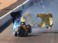 Feb 25, 2018; Chandler, AZ, USA; NHRA funny car driver John Force (front) explodes the body off his car on fire alongside Jonnie Lindberg during the Arizona Nationals at Wild Horse Pass Motorsports Park. Mandatory Credit: Mark J. Rebilas-USA TODAY Sports