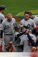 Brian Roberts of the United States is greeted by teammates during a game against Japan at the World Baseball Classic at Dodger Stadium on March 22, 2009 in Los Angeles, California. (Larry Goren/Four Seam Images)