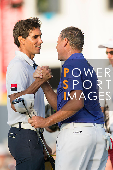 Rafael Cabrera Bello of Spain (left) congratulates Sam Brazel of Australia (right) after Brazel wins the tournament during the 58th UBS Hong Kong Golf Open as part of the European Tour on 11 December 2016, at the Hong Kong Golf Club, Fanling, Hong Kong, China. Photo by Lucas Schifres / Power Sport Images