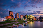 Sunset photo of Dayton Ohio skyline at river. Lovely pastel colors of the evening