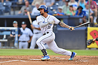 Asheville Tourists Niko Decolati (19) swings at a pitch during a game against the Rome Braves at McCormick Field on August 12, 2019 in Asheville, North Carolina. The Tourists defeated the Braves 11-6. (Tony Farlow/Four Seam Images)