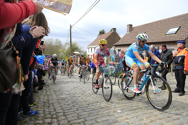 The peleton including Borut Bozic (SLV) Astana climb the Molenberg during the 2014 Tour of Flanders, Belgium.<br /> Picture: Eoin Clarke www.newsfile.ie