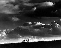 Boys run for home down a hillside in Lafayette, California before approaching storm. (1968 photo by Ron Riesterer)