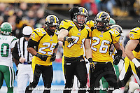 October 31, 2009; Hamilton, ON, CAN;  Hamilton Tiger-Cats defensive end Garrett McIntyre (71) celebrates recovering a Saskatchewan Roughriders fumble with linebacker Markeith Knowlton (25) and defensive back Chris Thompson (26). CFL football: Saskatchewan Roughriders vs. Hamilton Tiger-Cats at Ivor Wynne Stadium. The Tiger-Cats defeated the Roughriders 24-6. Mandatory Credit: Ron Scheffler. Copyright (c) 2009 Ron Scheffler.