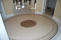 Custom Satori medallion shown in St. Richard, Travertine Noce, and Emperador Dark.