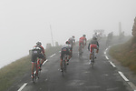 The peloton race through the fog during Stage 17 of the 2017 La Vuelta, running 180.5km from Villadiego to Los Machucos. Monumento Vaca Pasiega, Spain. 6th September 2017.<br /> Picture: Unipublic/&copy;photogomezsport   Cyclefile<br /> <br /> <br /> All photos usage must carry mandatory copyright credit (&copy; Cyclefile   Unipublic/&copy;photogomezsport)