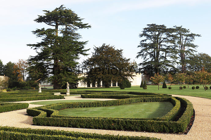 Tall cedar trees remain from the neo-classical origins of the house and garden