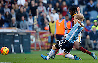 Calcio, Serie A: Roma vs Lazio. Roma, stadio Olimpico, 8 novembre 2015.<br /> Roma's Gervinho kicks to score as Lazio's Dusan Basta, foreground, tries to stop him during the Italian Serie A football match between Roma and Lazio at Rome's Olympic stadium, 8 November 2015.<br /> UPDATE IMAGES PRESS/Riccardo De Luca