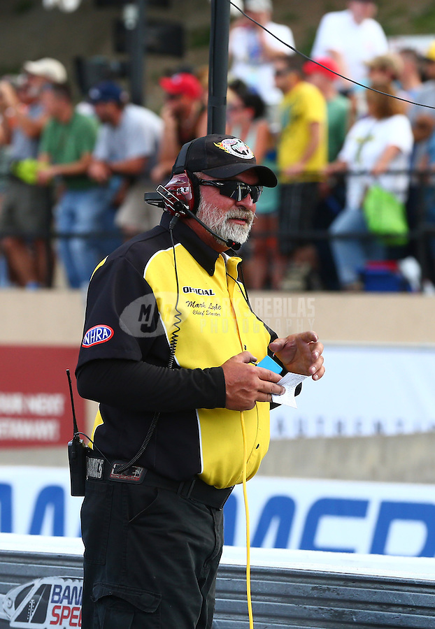 Jul. 19, 2013; Morrison, CO, USA: NHRA official starter Mark Lyle during qualifying for the Mile High Nationals at Bandimere Speedway. Mandatory Credit: Mark J. Rebilas-