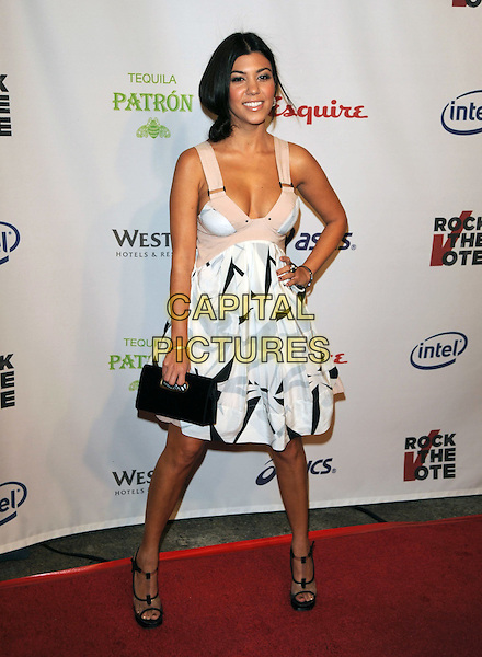 "KOURTNEY KARDASHIAN .The Esquire House Hollywood Hills ""Rock The Vote"" party in Hollywood, California, USA..September 25th, 2008                                                                     .full length black pattern hand on hip clutch bag white dress clear plastic platform sandals .CAP/DVS.©Debbie VanStory/Capital Pictures."