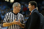 30 December 2015: Referee Tim Nestor (left) talks with Clemson head coach Brad Brownell. The University of North Carolina Tar Heels hosted the Clemson University Tigers at the Dean E. Smith Center in Chapel Hill, North Carolina in a 2015-16 NCAA Division I Men's Basketball game. UNC won the game 80-69.