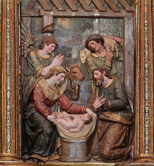 Nativity, with Mary and Joseph and the baby Jesus in the stable, with an angel worshipping and a shepherd, polychrome relief from the main altarpiece by Pablo de Rojas in Mannerist style, in the Monasterio de San Jeronimo, or Monastery of St Jerome, 16th century Roman Catholic church and Hieronymite monastery founded by the Catholic monarchs in Santa Fe, Granada, Andalusia, Southern Spain. Granada was listed as a UNESCO World Heritage Site in 1984. Picture by Manuel Cohen