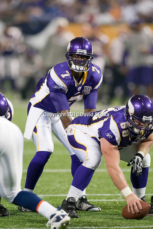 Minnesota Vikings quarterback Tarvaris Jackson (7) lines up under center Jon Cooper (68) during an NFL preseason football game against the Denver Broncos in Minneapolis, Minnesota on September 2, 2010. (AP Photo/David Stluka)