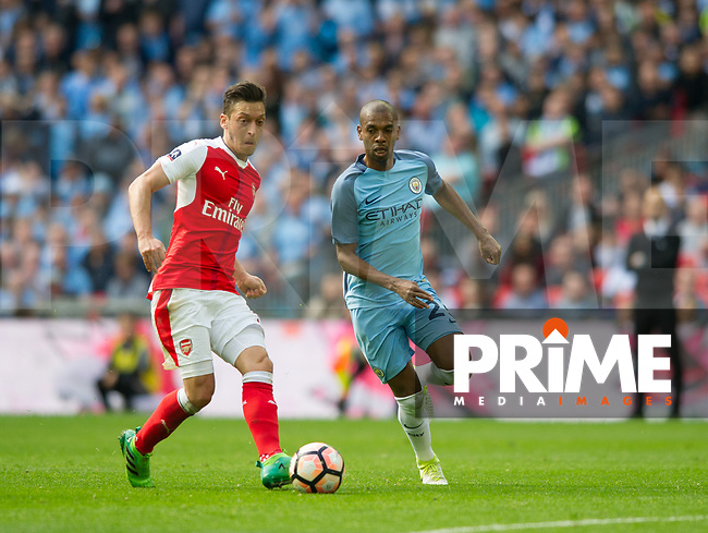 Arsenal's Mesut Ozil  and Manchester City Fernandinho Luiz Roza during the FA Cup Semi Final match between Manchester City and Arsenal at the Wembley  Stadium, Manchester, England on 23 April 2017. Photo by Andrew Aleksiejczuk / PRiME Media Images.