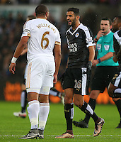 Riyad Mahrez of Leicester City and Ashley Williams of Swansea City get involved in an argument during the Barclays Premier League match between Swansea City and Leicester City played at The Liberty Stadium on 5th December 2015