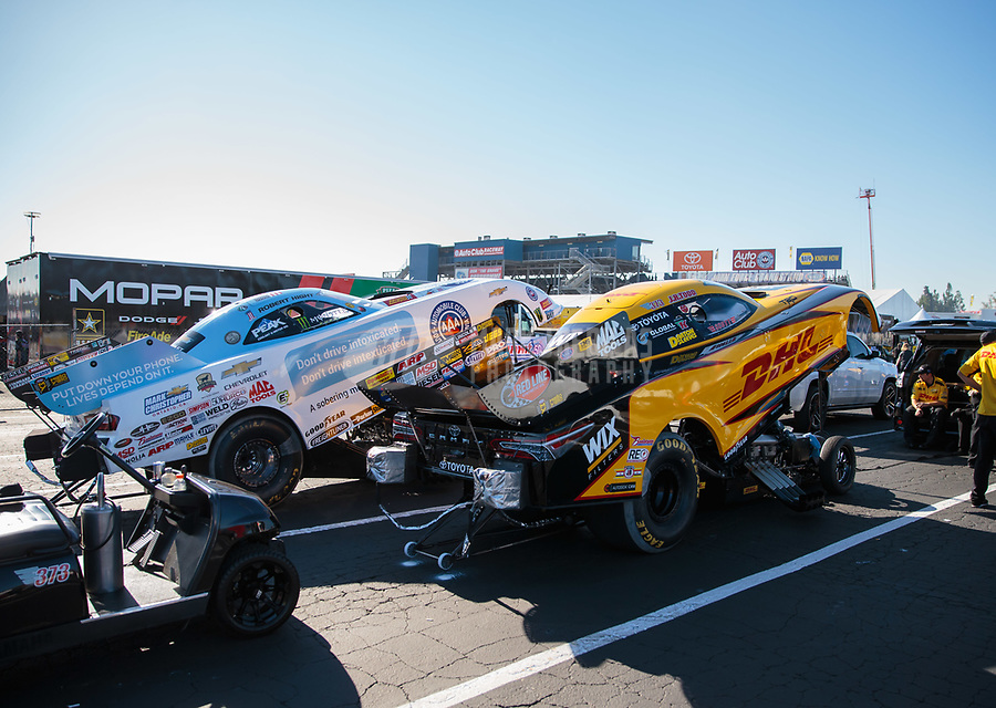 Nov 9, 2018; Pomona, CA, USA; The cars of NHRA funny car driver J.R. Todd (right) and Robert Hight during qualifying for the Auto Club Finals at Auto Club Raceway. Mandatory Credit: Mark J. Rebilas-USA TODAY Sports