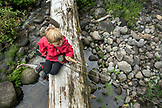 USA, Oregon, Santiam River, Brown Cannon, a young boy waiting to go fishing on the Santiam River