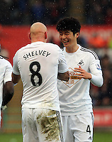 SWANSEA, WALES - FEBRUARY 21: L-R Jonjo Shelvey of Swansea celebrates his goal with co-scorer Ki Sung Yueng, making the score 2-1 to his team during the Barclays Premier League match between Swansea City and Manchester United at Liberty Stadium on February 21, 2015 in Swansea, Wales.
