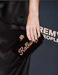 HOLLYWOOD, CA - SEPTEMBER 08: Singer Katy Perry, handbag detail, at the Premiere Of The Vladar Company's 'Jeremy Scott: The People's Designer' at TCL Chinese 6 Theatres on September 8, 2015 in Hollywood, California.