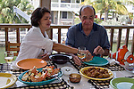 Father & daughter enjoy the local fare of stone crab claws and conch fritters.