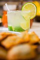 Caipirinha served at Bar do Mineiro, Santa Teresa quarter, Rio de Janeiro - caipirinha is Brazil's national cocktail, made with cachaca ( sugarcane hard liquor ), sugar and lime. Cachaca, also known as Pinga or Caninha, is Brazil's most common distilled alcoholic beverage.