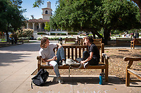 Dawson Engstrom '20 and Zoe Foster-La Du '19 talk on a bench in the Academic Quad at the start of Reading Days, May 1, 2019.<br /> (Photo by Marc Campos, Occidental College Photographer)
