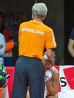 Arena Loire,  Trélazé,  France, 16 April, 2016, Semifinal FedCup, France-Netherlands, Doubles: Hogenkamp is comfort after her los by coach Martin Bohm(NED)<br /> Photo: Henk Koster/Tennisimages