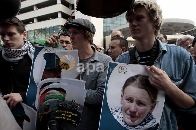 Palestinians and foreigners hold a portrait of Rachel Corrie, a US peace activist during a protest of the 10th anniversary of the death of Rachel Corrie in the West Bank city of Nablus 16 March 2013. who was run over in 2003 in the Gaza Strip by an Israeli army bulldozer. Corrie, an American activist for the International Solidarity Movement (ISM), had tried to prevent the bulldozer from demolishing Palestinian homes, in a security zone along the border with Egypt. Photo by Nedal Eshtayah