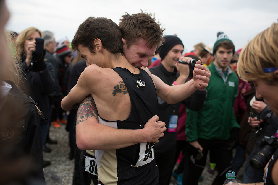 Colorado teammates Jake Hurysz and Blake Theroux, right, hug after the team won the title during the NCAA Cross Country Championships in Terre Haute, Ind. on Saturday, Nov. 22, 2014. (James Brosher, Special to the Denver Post)