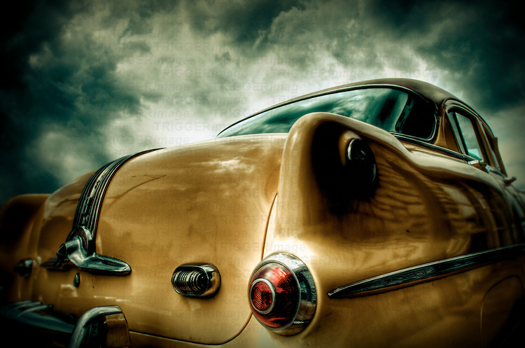 An old 1950's American Pontiac car seen from the rear bumper