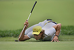 7 September 2008:    Camilo Villegas does his signature balancing act to check the path of his putt in the fourth and final round of play at the BMW Golf Championship at Bellerive Country Club in Town & Country, Missouri, a suburb of St. Louis, Missouri on Sunday September 7, 2008. The BMW Championship is the third event of the PGA's  Fed Ex Cup Tour.