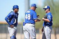 Kansas City Royals catcher Pedro Gonzalez (43), pitching coach Mark Davis (48), and pitcher Jake Newberry (38) during an instructional league game against the Seattle Mariners on October 2, 2013 at Surprise Stadium Training Complex in Surprise, Arizona.  (Mike Janes/Four Seam Images)