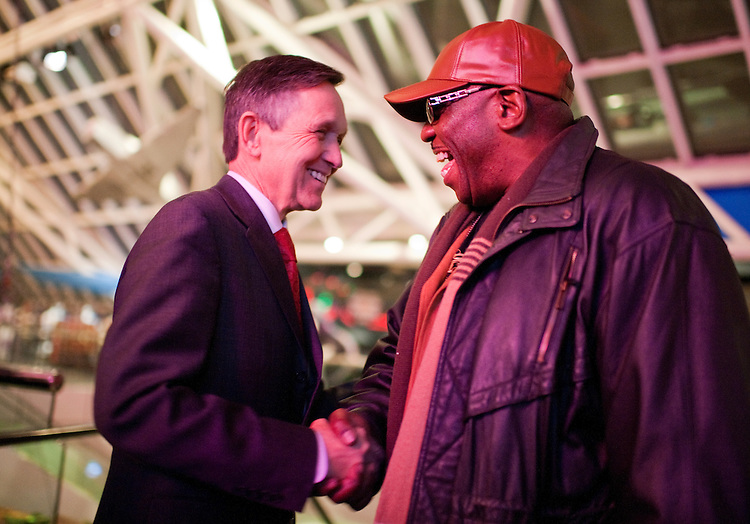 UNITED STATES - FEBRUARY 10:  Rep. Dennis Kucinich, D-Ohio, greets an attendee during an event at the Rock and Roll Hall of Fame to honor wounded veterans in Cleveland, Ohio.  Rep. Marcy Kaptur, D-Ohio, and Kucinich are running for the OH-09 seat after the state lost two seats due to reapportionment.  (Photo By Tom Williams/CQ Roll Call)