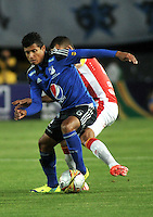 BOGOTA - COLOMBIA -14 -03-2015: Luis Mosquera (Izq.) jugador de Millonarios disputa el balón con Sergio Otalvaro (Der.) jugador de Independiente Santa Fe, durante partido entre Millonarios e Independiente Santa Fe por la fecha 10 de la Liga Aguila I-2015, jugado en el estadio Nemesio Camacho El Campin de la ciudad de Bogota. / Luis Mosquera (L) player of Millonarios vies for the ball with Sergio Otalvaro (R) player of Independiente Santa Fe, during a match between Millonarios and Independiente Santa Fe, for the  date 10 of the Liga Aguila I-2015 at the Nemesio Camacho El Campin Stadium in Bogota city, Photo: VizzorImage / Luis Ramirez / Staff.