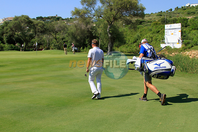 Luke Donald (ENG) and caddy John McClarren walk onto the 13th green during the morning Semi-Final session on the Final Day of the Volvo World Match Play Championship in Finca Cortesin, Casares, Spain, 22nd May 2011. (Photo Eoin Clarke/Golffile 2011)