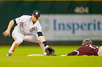 Michael Ratterree #8 of the Rice Owls fields a throw as Matt Juengel #17 of the Texas A&M Aggies slides head first into second base at Minute Maid Park on March 5, 2011 in Houston, Texas.  Photo by Brian Westerholt / Four Seam Images