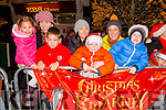 L-R Cliona, Teresa and Darren O'Sullivan from Waterville and Catherine, Ryan, Aoife and Adam Twomey from Killarney at the Christmas in Killarney Children's Magic Parade last Saturday.