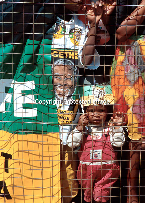 ppchild50220 A pre-election ANC rally in February-1999 in Soweto, South Africa. A child with an ANC flag at the rally which was attended by President Nelson Mandela and the future deputy President Thabo Mbeki. .©Per-Anders Pettersson /iAfrika Photos