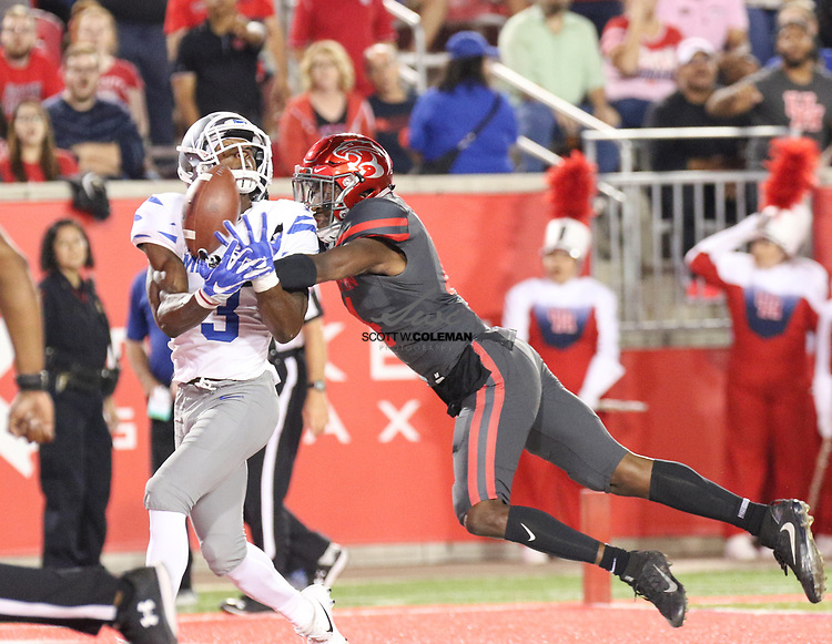 Houston Cougars cornerback Isaiah Johnson (14) knocks away a pass in the end zone intended for Memphis Tigers wide receiver Anthony Miller (3) during the second quarter of an NCAA football game between the Houston Cougars and the Memphis Tigers at TDECU Stadium in Houston, Texas.