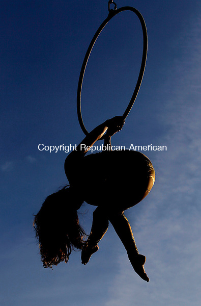 Oxford, CT-02, July 2010-070210CM09  Rosie Eastman, of Cristiani Brothers and Reid Imperial Circus, performs an acrobatics routine Friday night at the Quaker Farms Fire Company Carnival.  --Christopher Massa Republican-American