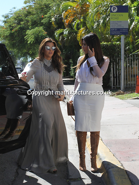 NON EXCLUSIVE PICTURE: MATRIXPICTURES.CO.UK.PLEASE CREDIT ALL USES..UK, AUSTRALIA, NEW ZEALAND AND ASIA RIGHTS ONLY..American reality television stars Kim and Kourtney Kardashian are pictured near Miami Beach with friend Jonathan Cheban whilst filming their reality series 'Kourtney and Kim Take Miami' today...OCTOBER 29th 2012..REF: KDA 124924..XIM