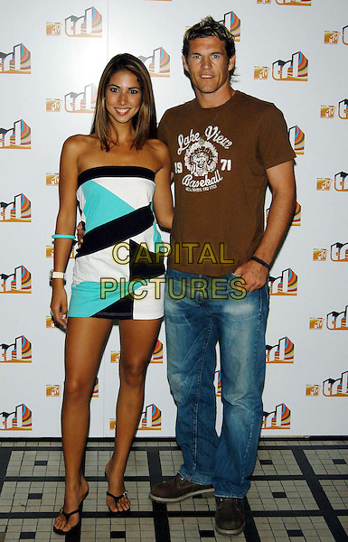 LEILANI, MARK WILLIAMS.page three girl.MTV TLR launch party.TLR UK launch date: 19 August 2003.sales@capitalpictures.com.www.capitalpictures.com.©Capital Pictures.same dress as javine hylton, strapless turquoise, black and white print mini dress, watch, bangle, same outfit.full length, full-length