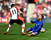 Chelsea's Eden Hazard (right) is tackled by Southampton's Dusan Tadic (left)  <br /> <br /> Photographer David Horton/CameraSport<br /> <br /> The Premier League - Southampton v Chelsea - Saturday 14th April2018 - St Mary's Stadium - Southampton<br /> <br /> World Copyright &copy; 2018 CameraSport. All rights reserved. 43 Linden Ave. Countesthorpe. Leicester. England. LE8 5PG - Tel: +44 (0) 116 277 4147 - admin@camerasport.com - www.camerasport.com